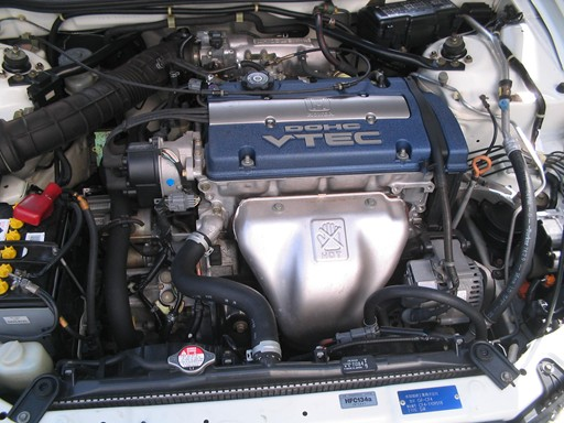 The SiR model has a blue engine and is a DOHC VTEC.